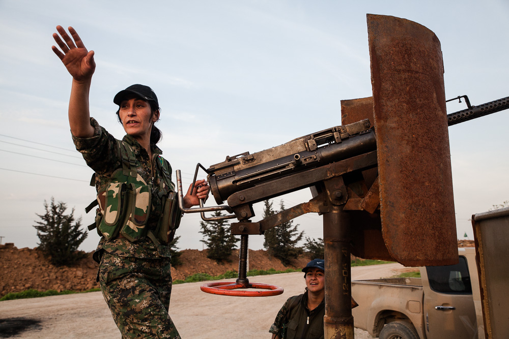 Female Kurdish fighter with heavy machinegun
